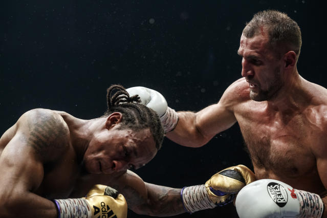 Boxers Anthony Yarde of Britain, left, and Sergey Kovalev of Russia exchange blows during their WBO light heavyweight title bout in Chelyabinsk, Russia, Saturday, Aug. 24, 2109. (AP Photo/Anton Basanayev)