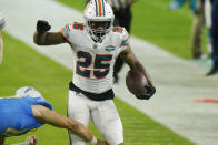 Miami Dolphins cornerback Xavien Howard (25) runs after intercepting a pass during the second half of an NFL football game against the Los Angeles Chargers, Sunday, Nov. 15, 2020, in Miami Gardens, Fla. (AP Photo/Lynne Sladky)