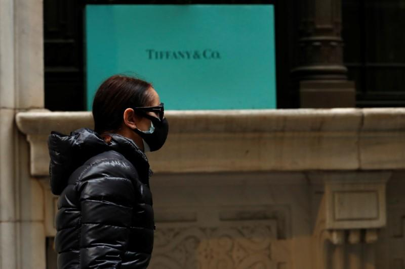 FILE PHOTO: A man passes by the closed Tiffany & Co store on Wall St. in the financial district of New York