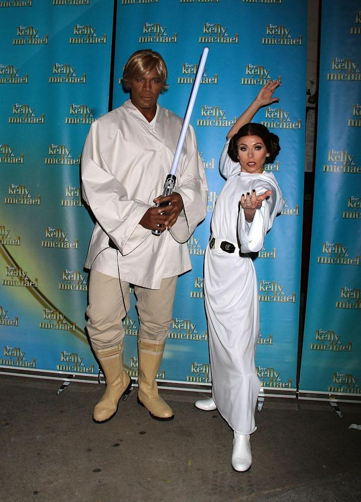 """<p><a href=""""https://www.womansday.com/style/g28692510/star-wars-costume-ideas/"""" rel=""""nofollow noopener"""" target=""""_blank"""" data-ylk=""""slk:Stars Wars costumes"""" class=""""link rapid-noclick-resp""""><em>Stars Wars</em> costumes</a> never out of style, and the force will definitely be with you and your boo when you take on Princess Leia and Luke Skywalker together. </p><p><a class=""""link rapid-noclick-resp"""" href=""""https://www.amazon.com/Star-Wars-Knight-Qui-Gon-Lightsaber/dp/B00004U3N3?tag=syn-yahoo-20&ascsubtag=%5Bartid%7C10070.g.1923%5Bsrc%7Cyahoo-us"""" rel=""""nofollow noopener"""" target=""""_blank"""" data-ylk=""""slk:SHOP LIGHTSABER"""">SHOP LIGHTSABER</a></p><p><a class=""""link rapid-noclick-resp"""" href=""""https://www.amazon.com/Made-Johnny-WDR2037-Womens-Sleeve/dp/B07KBJ6JTK?tag=syn-yahoo-20&ascsubtag=%5Bartid%7C10070.g.1923%5Bsrc%7Cyahoo-us"""" rel=""""nofollow noopener"""" target=""""_blank"""" data-ylk=""""slk:SHOP WHITE DRESS"""">SHOP WHITE DRESS</a></p>"""