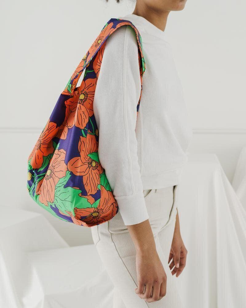 """Buy groceries the eco-friendly way with a reusable bag. Bonus: they fold down into tiny pouches you can fit in your pocket. (Or, ahem, in a stocking.) Get it in a variety of colours and patterns <a href=""""https://baggu.com/collections/reusable-bags"""" target=""""_blank"""" rel=""""noopener noreferrer"""">at Baggu</a> for $15.85."""