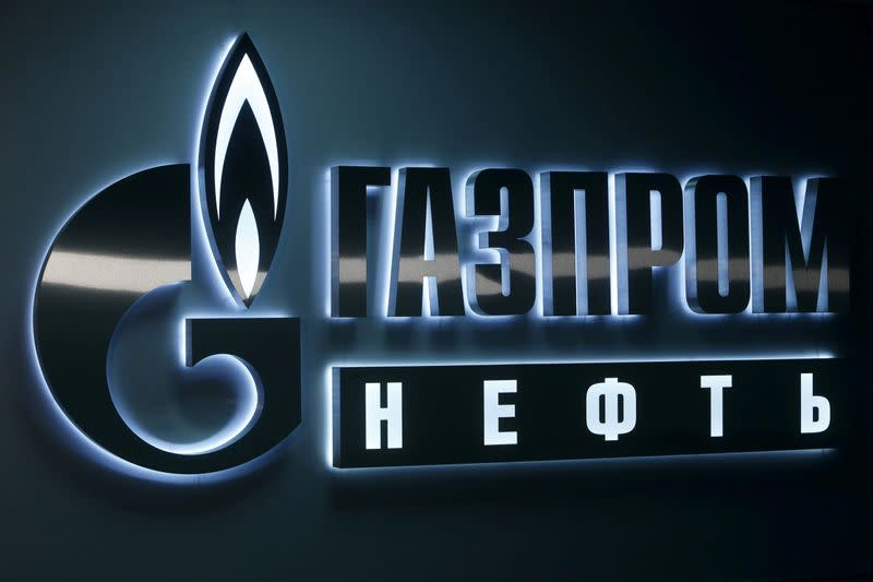 Sign displaying the logo of Russia's Gazprom Neft oil company is seen at company's office in West Siberian city of Khanty-Mansiysk