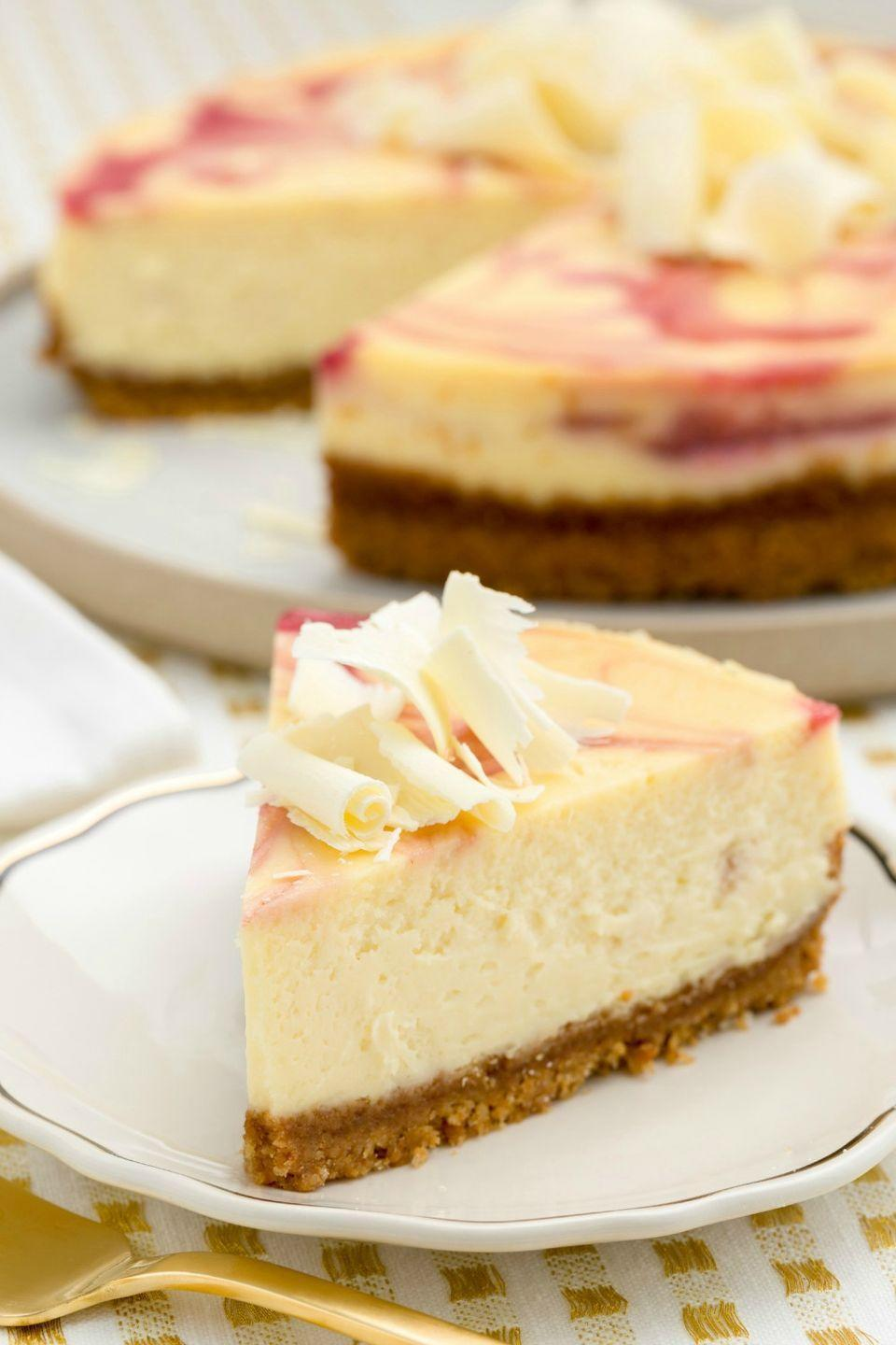 """<p>With a decadent raspberry swirl, this cheesecake looks as decadent as it tastes.</p><p>Get the recipe from <a href=""""/cooking/recipe-ideas/recipes/a45124/white-chocolate-cheesecake-raspberry-swirl-recipe/"""" data-ylk=""""slk:Delish"""" class=""""link rapid-noclick-resp"""">Delish</a>.</p>"""