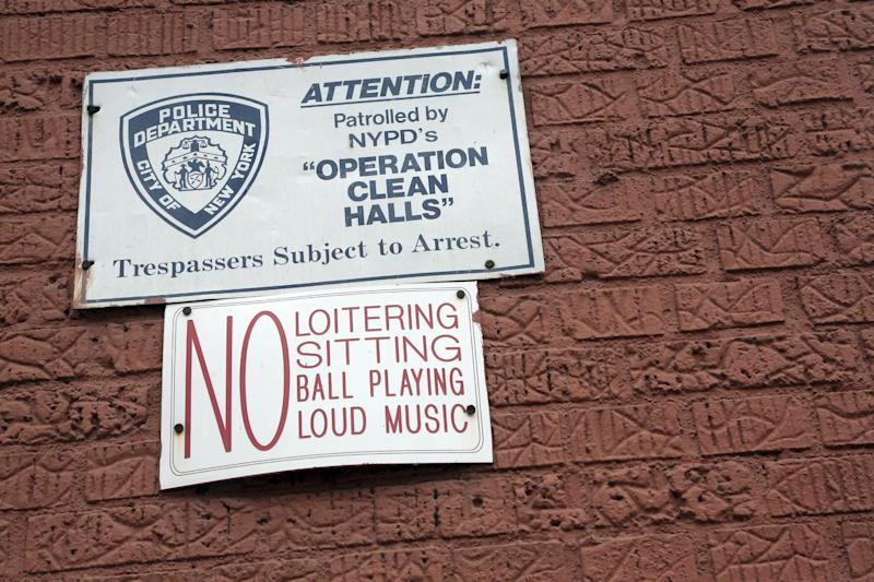 "In this Wednesday, March 6 2013 photo, a sign is posted on the wall of a building in the Bronx borough of New York. The building is one of thousands of private dwellings patrolled by the New York Police Department under a program known as ""Operation Clean Halls."" (AP Photo/Mary Altaffer)"