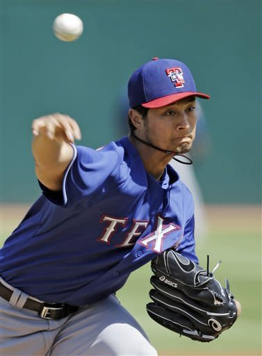Texas Rangers starting pitcher Yu Darvish delivers against the Cincinnati Reds in the first inning of an exhibition spring training baseball game on Saturday, March 23, 2013, in Goodyear, Ariz. (AP Photo/Mark Duncan)
