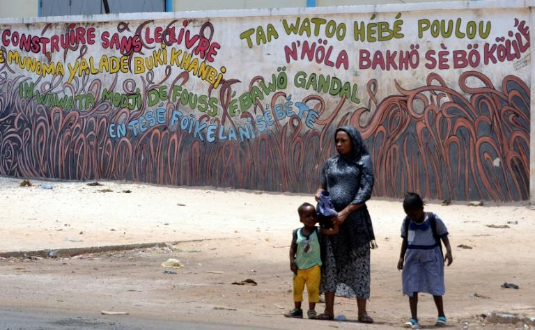 """Nothing can be built without a book"" proclaims graffiti on a wall in Conakry. For a country struggling with high rates of poverty, buying books can slip as a priority when it is sometimes difficult to cover basic needs"