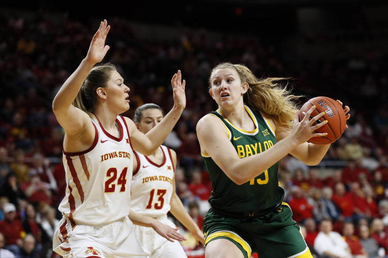 Baylor forward Lauren Cox, right, drives to the basket past Iowa State guard Ashley Joens (24) during the first half of an NCAA college basketball game, Sunday, March 8, 2020, in Ames, Iowa. (AP Photo/Charlie Neibergall)