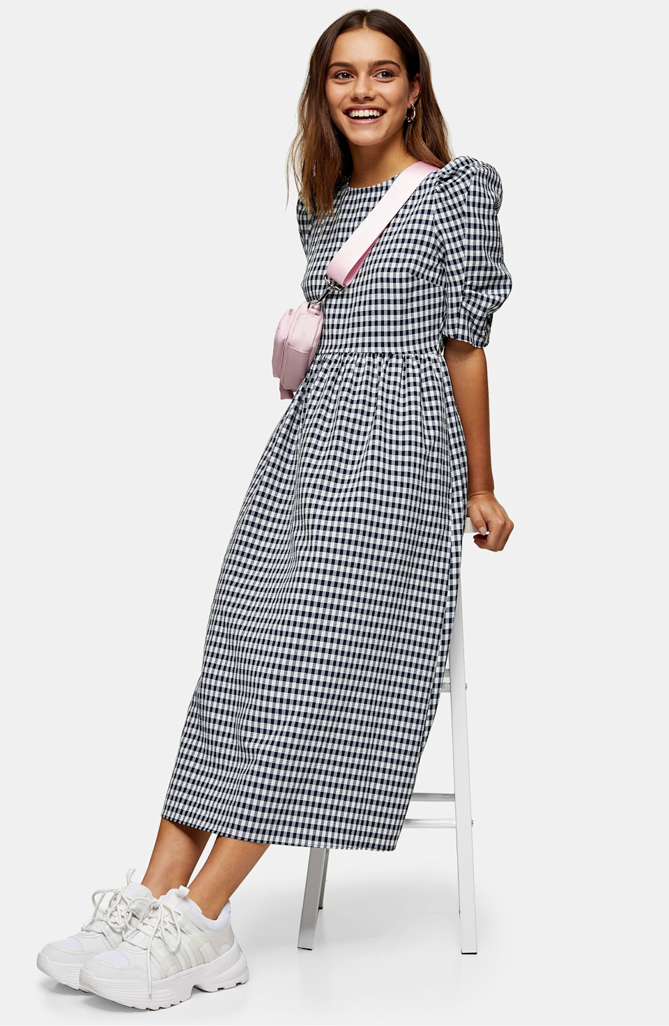 "Topshop is offering up to <a href=""https://us.topshop.com/en/tsus/category/sale-6923951/up-to-40-off-selected-lines-9508100?"" rel=""nofollow noopener"" target=""_blank"" data-ylk=""slk:30% off new summer deliveries"" class=""link rapid-noclick-resp"">30% off new summer deliveries</a>. <br> <br> <strong>Topshop</strong> Gingham Cross Back Smock Midi Dress, $, available at <a href=""https://go.skimresources.com/?id=30283X879131&url=https%3A%2F%2Fus.topshop.com%2Fen%2Ftsus%2Fproduct%2Fblack-and-white-gingham-cross-back-smock-midi-dress-9756825"" rel=""nofollow noopener"" target=""_blank"" data-ylk=""slk:Topshop"" class=""link rapid-noclick-resp"">Topshop</a>"
