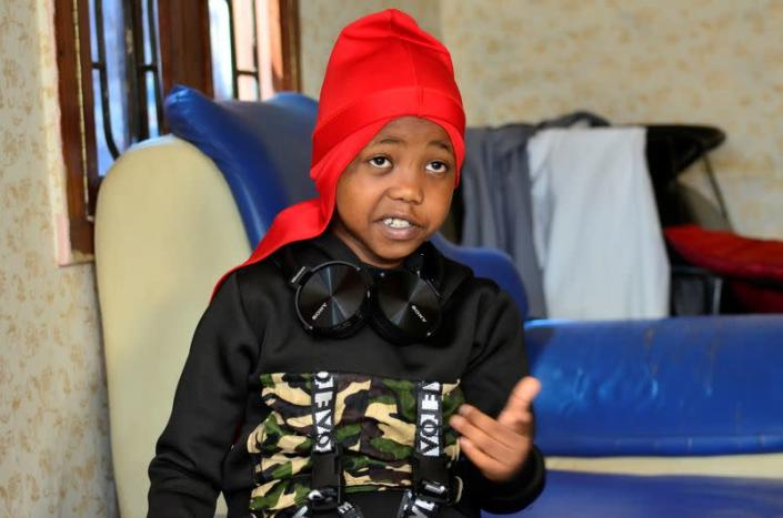 """Ugandan eight-year-old rapper """"Fresh Kid"""", whose real name is Patrick Ssenyonjo, speaks during an interview with Reuters in Bukoto, a suburb of Kampala"""