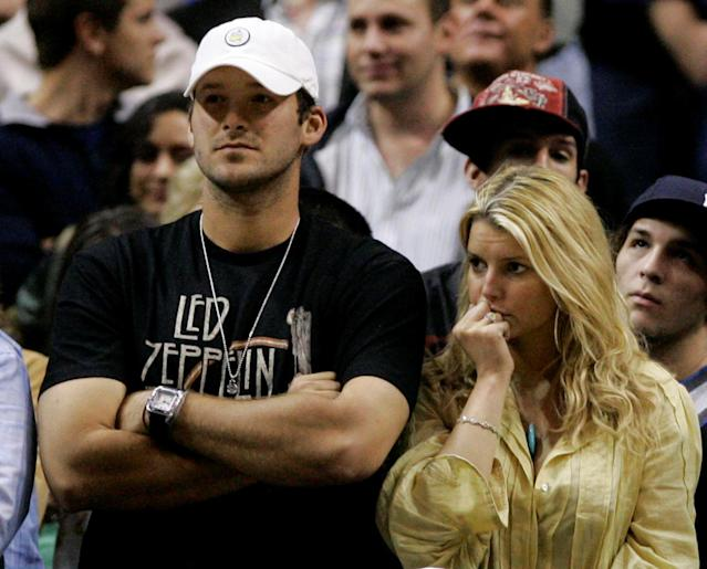 Tony Romo and Jessica Simpson were connected for a long time, a connective symbol of failure. (AP)