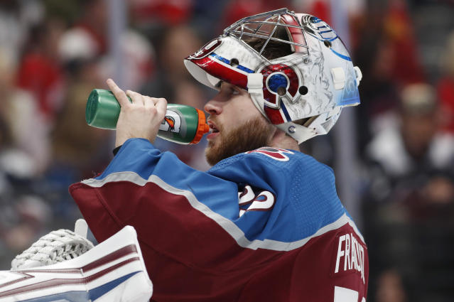 Colorado Avalanche goaltender Pavel Francouz drinks during a timeout in the second period of an NHL hockey game against the Detroit Red Wings, Monday, Jan. 20, 2020, in Denver. (AP Photo/David Zalubowski)