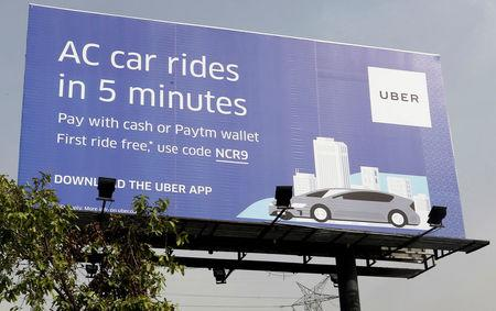 FILE PHOTO: A billboard of ride-hailing service Uber is pictured on a highway in New Delhi