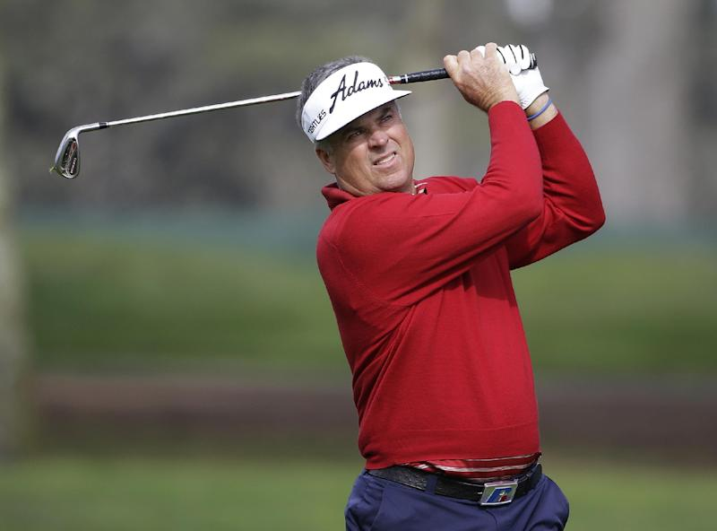 Kenny Perry follows his shot from fairway to the second green during the final round of the Charles Schwab Cup Championship Champions Tour golf tournament Sunday, Nov. 3, 2013, in San Francisco. (AP Photo/Eric Risberg)