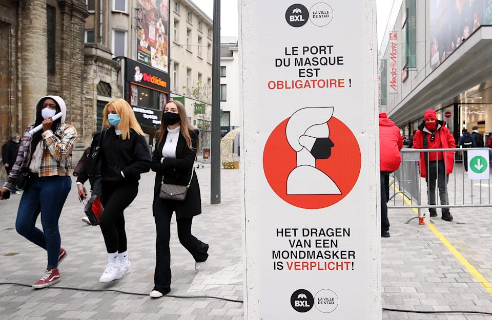 A sign warns people to wear mask in open public areas is seen as coronavirus (Covid-19) restriction currently in force, in the capital city Brussels, Belgium on December 02, 2020