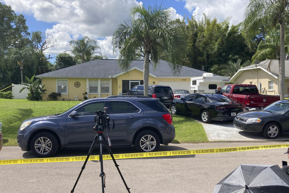 Police tape blocks off the home of Brian Laundrie's parents in North Port, Fla., Monday, Sept. 20, 2021. Laundrie, 23, was traveling on a cross-country road trip with Gabby Petito, 22, who went missing in August. Petito's body was apparently discovered over the weekend at Grand Teton National Park. Laundrie is wanted for questioning, but has not been seen for several days. (AP Photo/Curt Anderson)