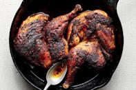 "The real magic here is in the pool of schmaltz—also known as rendered chicken fat—sizzling in the skillet. <a href=""https://www.epicurious.com/recipes/food/views/roast-chicken-with-harissa-and-schmaltz?mbid=synd_yahoo_rss"" rel=""nofollow noopener"" target=""_blank"" data-ylk=""slk:See recipe."" class=""link rapid-noclick-resp"">See recipe.</a>"