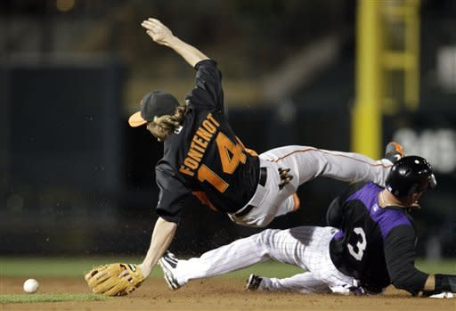 Colorado Rockies' Michael Cuddyer (3) slides into San Francisco Giants second baseman Mike Fontenot, preventing a double play on a ground ball by Casey Blake during the second inning of a spring training baseball game Thursday, March 22, 2012, in Scottsdale, Ariz. (AP Photo/Marcio Jose Sanchez)