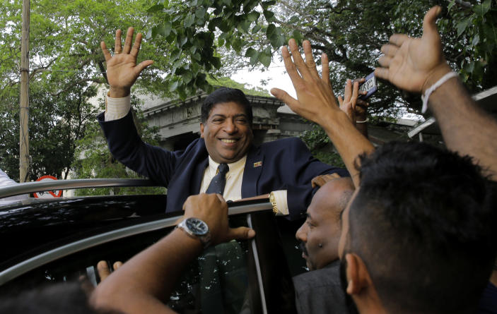 Ravi Karunanayake, a Sri Lankan lawmaker loyal to ousted Prime Minister Ranil Wickremesinghe, celebrates with other supporters outside the supreme court complex in Colombo, Sri Lanka, Thursday, Dec. 13, 2018. Sri Lanka's Supreme Court unanimously ruled as unconstitutional President Maithripala Sirisena's order to dissolve Parliament and call for fresh elections, a much-anticipated verdict Thursday that further embroils the Indian Ocean island nation in political crisis.(AP Photo/Eranga Jayawardena)
