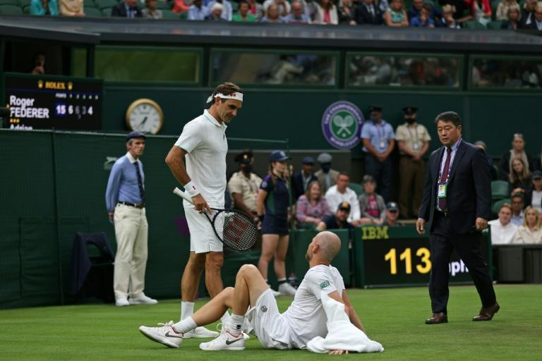 Swiss tennis legend Roger Federer moved into the second round of Wimbledon but the eight time champion did so with his match level at two sets each only for opponent Adrian Mannarino to injure hinmself in a fall