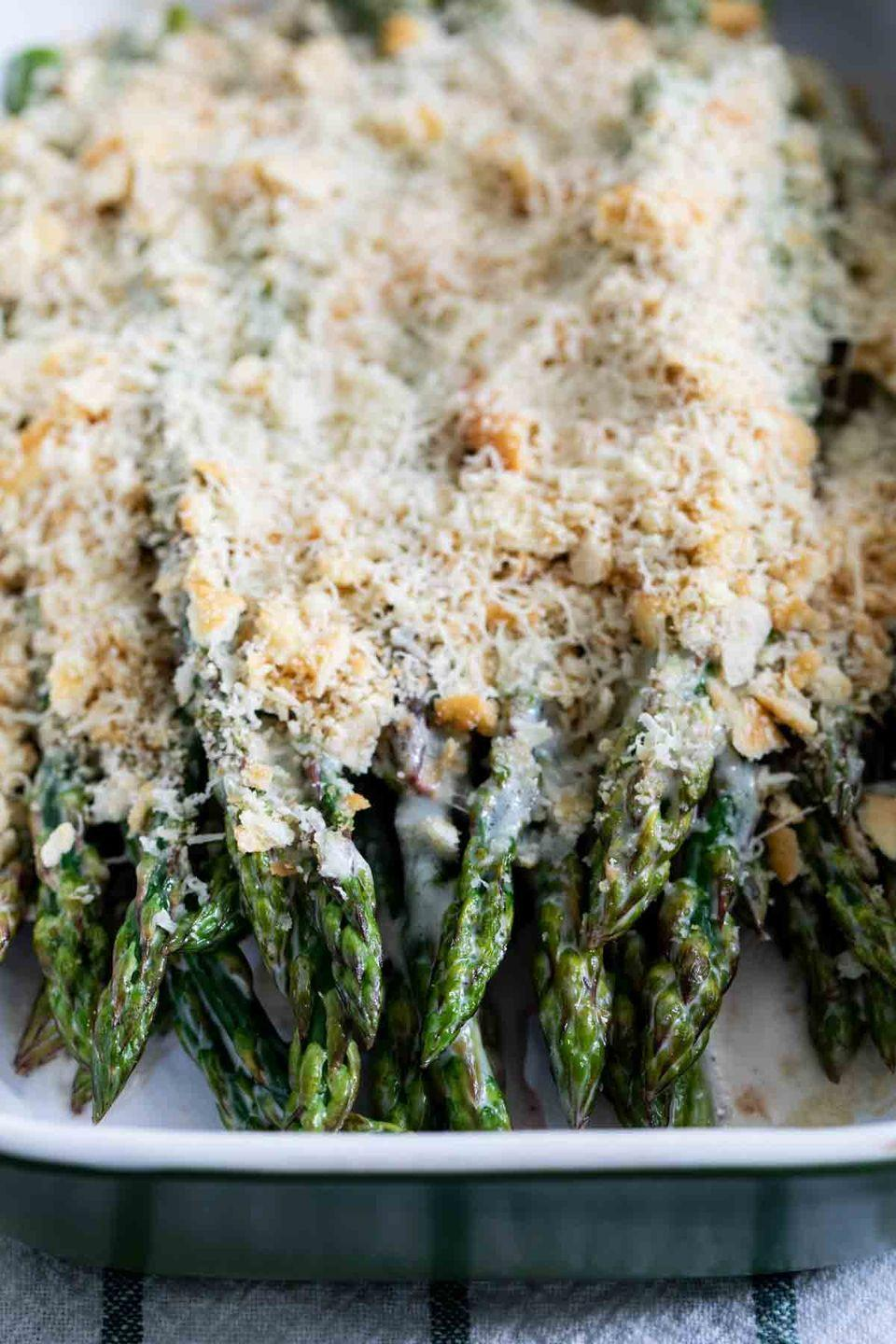 "<p>You only need four ingredients to make this simple asparagus dish together.</p><p><strong>Get the recipe at <a href=""https://www.tasteandtellblog.com/easy-creamy-baked-asparagus/"" rel=""nofollow noopener"" target=""_blank"" data-ylk=""slk:Taste and Tell"" class=""link rapid-noclick-resp"">Taste and Tell</a>. </strong></p><p><strong><a class=""link rapid-noclick-resp"" href=""https://go.redirectingat.com?id=74968X1596630&url=https%3A%2F%2Fwww.walmart.com%2Fbrowse%2Fhome%2Fserveware%2Fthe-pioneer-woman%2F4044_623679_639999_2347672%3Ffacet%3Dbrand%253AThe%2BPioneer%2BWoman&sref=https%3A%2F%2Fwww.thepioneerwoman.com%2Ffood-cooking%2Fmeals-menus%2Fg33251890%2Fbest-thanksgiving-sides%2F"" rel=""nofollow noopener"" target=""_blank"" data-ylk=""slk:SHOP SERVING PLATTERS"">SHOP SERVING PLATTERS</a><br></strong></p>"