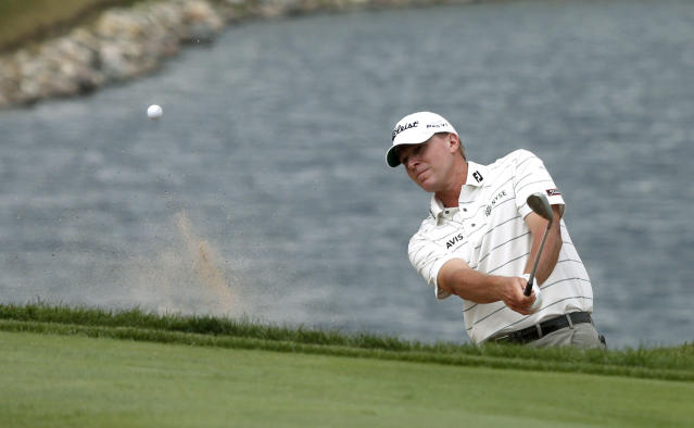 Steve Stricker hits out of the sand on the eighth green during the first round of the BMW Championship golf tournament at Conway Farms Golf Club in Lake Forest, Ill., Thursday, Sept. 12, 2013. (AP Photo/Charles Rex Arbogast)
