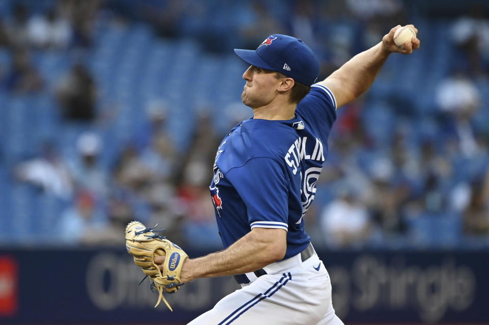 Toronto Blue Jays starting pitcher Ross Stripling throws to a Cleveland Indians batter during the first inning of a baseball game Thursday, Aug. 5, 2021, in Toronto. (Jon Blacker/The Canadian Press via AP)