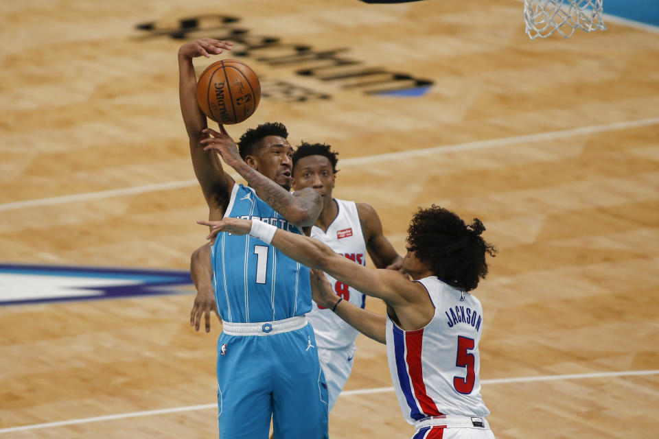Charlotte Hornets guard Malik Monk (1) tries to pass over Detroit Pistons guard Frank Jackson (5) in the second half of an NBA basketball game in Charlotte, N.C., Saturday, May 1, 2021. (AP Photo/Nell Redmond)