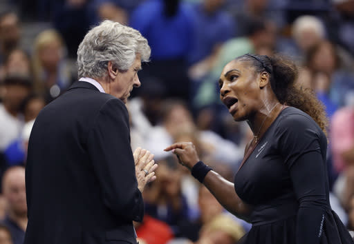 Serena Williams (R) talks with referee Brian Earley during the women's final of the U.S. Open tennis tournament against Naomi Osaka Saturday, Sept. 8, 2018, in New York. (AP Photo/Adam Hunger)