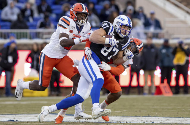 Duke's Noah Gray (87) is tackled by Syracuse's Evan Foster, left, and Andre Cisco, right, during the first half of an NCAA college football game in Durham, N.C., Saturday, Nov. 16, 2019. (AP Photo/Ben McKeown)