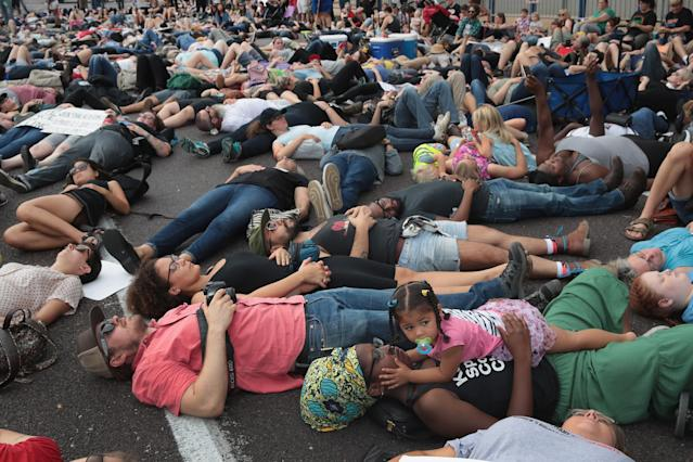<p>Demonstrators protesting the acquittal of former St. Louis police officer Jason Stockley stage a die-in in front of police headquarters on Sept.17, 2017 in St. Louis, Missouri. This is the third day of protests in the city following the acquittal of Stockley, who had been charged with first-degree murder last year following the 2011 on-duty shooting of Anthony Lamar Smith. (Photo: Scott Olson/Getty Images) </p>