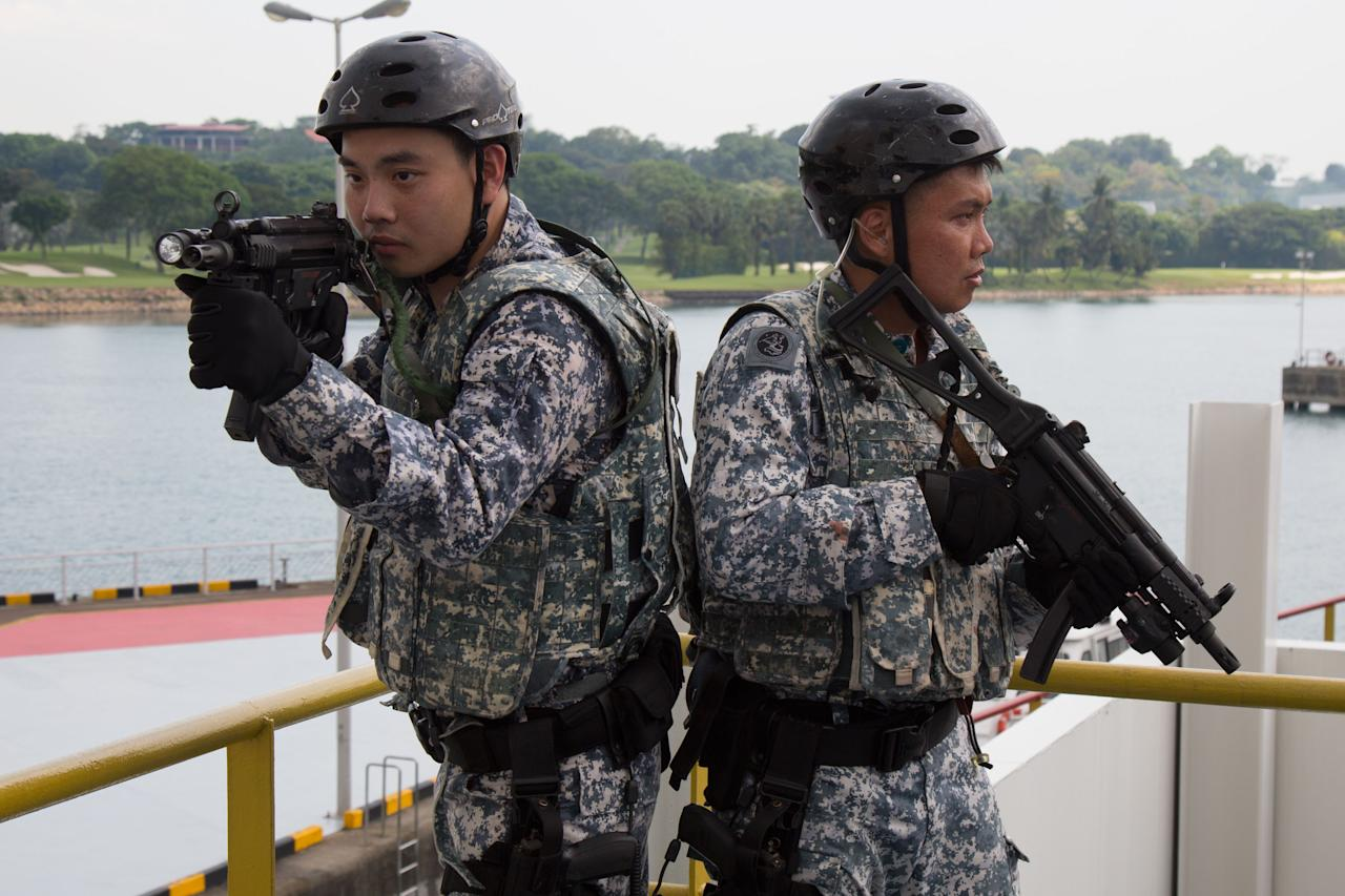 "<p>ASSeT troops – the navy's ""sea marshals"" – posing for the media on 17 April 2018. (PHOTO: Yahoo News Singapore / Dhany Osman) </p>"