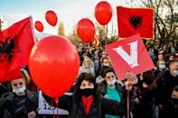 Supporters of the Vetevendosje (Selfdetermination) movement wave Albanian flags during a campaign rally in the town of Gjakova on February 7