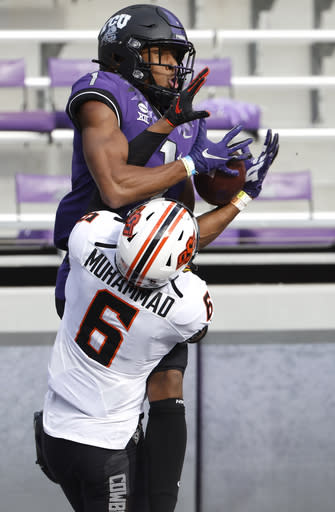 TCU wide receiver Quentin Johnston (1) catches a pass over Oklahoma State cornerback Jabbar Muhammad (6) in the end zone for a two-point conversion during the second half of an NCAA college football game Saturday, Dec. 5, 2020, in Fort Worth, Texas. (AP Photo/Ron Jenkins)