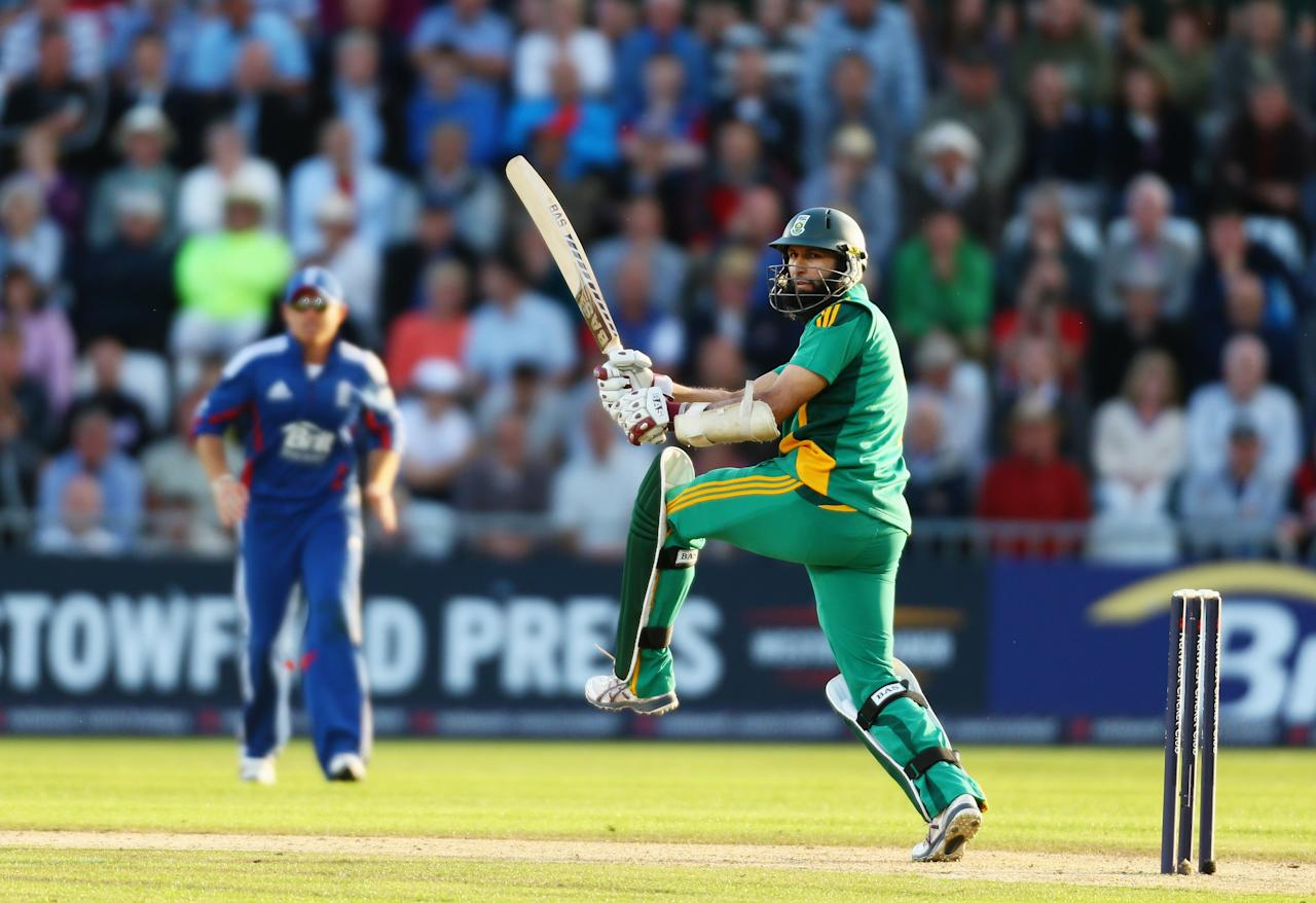 NOTTINGHAM, ENGLAND - SEPTEMBER 05:  Hashim Amla of South Africa hits out during the Fifth NatWest Series One Day International match between England and South Africa at Trent Bridge on September 5, 2012 in Nottingham, England.  (Photo by Paul Gilham/Getty Images)