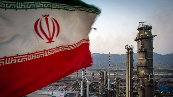 PHOTO: An Iranian national flag flies at the Persian Gulf Star Co. gas condensate refinery in Bandar Abbas, Iran, Jan. 9. 2019. (Ali Mohammadi/Bloomberg via Getty Images, FILE)