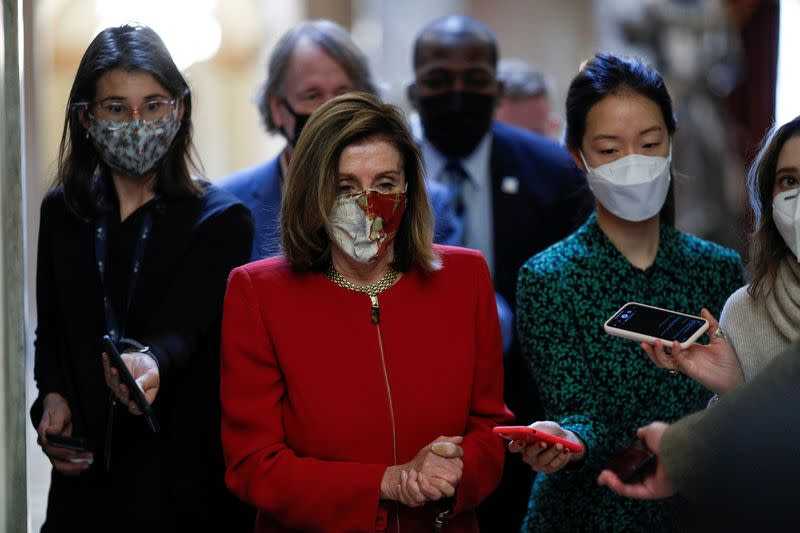FILE PHOTO: Speaker of the House Pelosi speaks to reporters on Capitol Hill in Washington