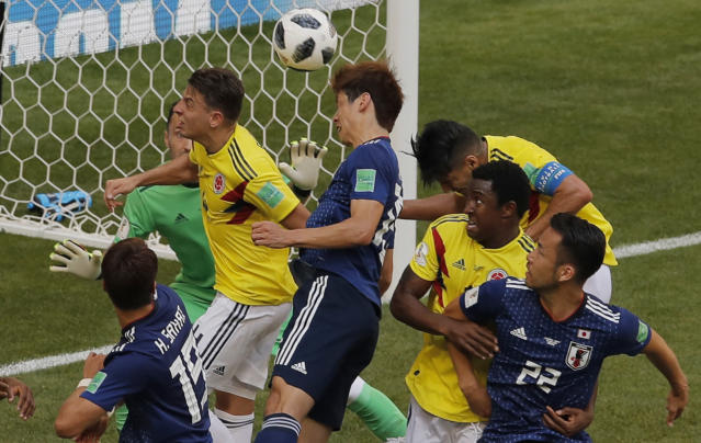<p> Japan's Yuya Osako, center, scores his side second goal during the group H match between Colombia and Japan at the 2018 soccer World Cup in the Mordavia Arena in Saransk, Russia, Tuesday, June 19, 2018. (AP Photo/Vadim Ghirda) </p>