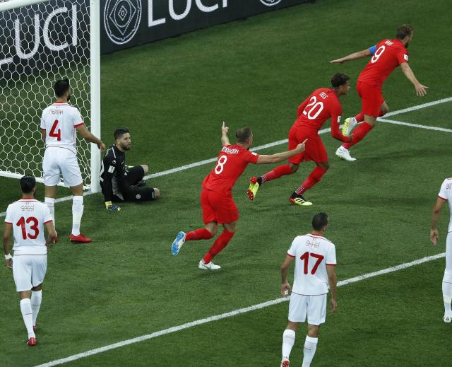 England's Harry Kane, right, celebrates his side's opening goal during the group G match between Tunisia and England at the 2018 soccer World Cup in the Volgograd Arena in Volgograd, Russia, Monday, June 18, 2018. (AP Photo/Rebecca Blackwell)