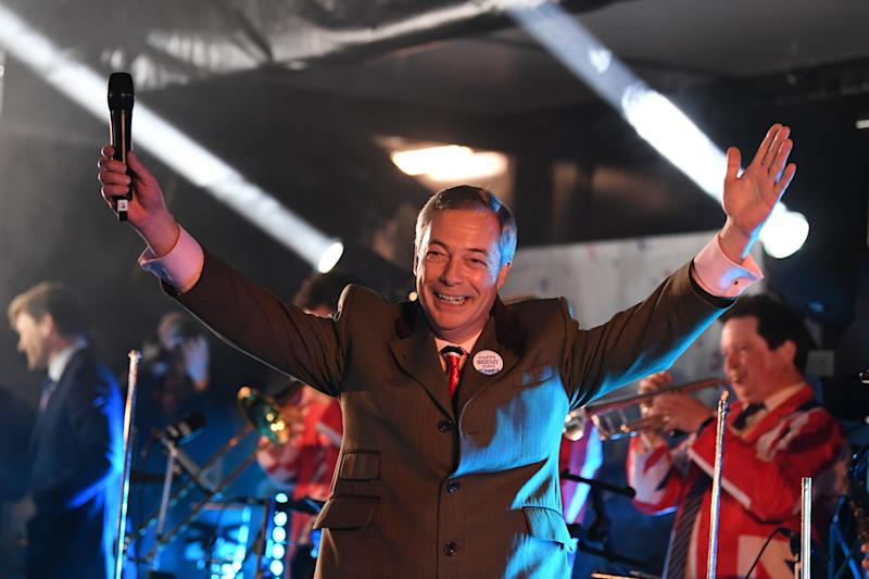 Brexit Party leader Nigel Farage gestures to the crowd from the stage in Parliament Square after addressing thousands at the Leave Means Leave party. (Getty)