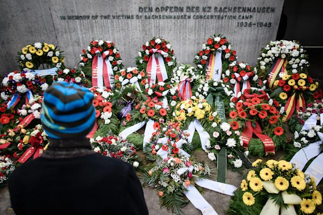 <p><br>A guest stands in front of wreaths during a remembrance ceremony at the former concentration camp Sachsenhausen in Oranienburg near Berlin, Germany, Jan. 27, 2018. Today world commemorates The International Holocaust Remembrance Day. (Photo: Clemens Bilan/EPA-EFE/REX/Shutterstock) </p>