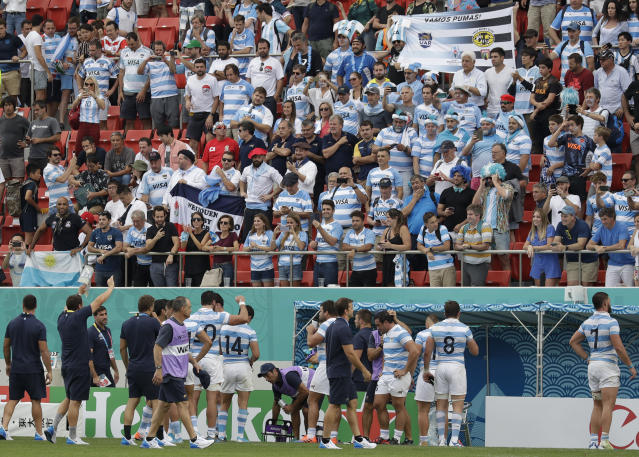 Argentina rugby team players are greeted by the crowd after winning 28-12 against Tonga during the Rugby World Cup Pool C game at Hanazono Rugby Stadium in Osaka, Japan, Saturday, Sept. 28, 2019. (AP Photo/Aaron Favila)