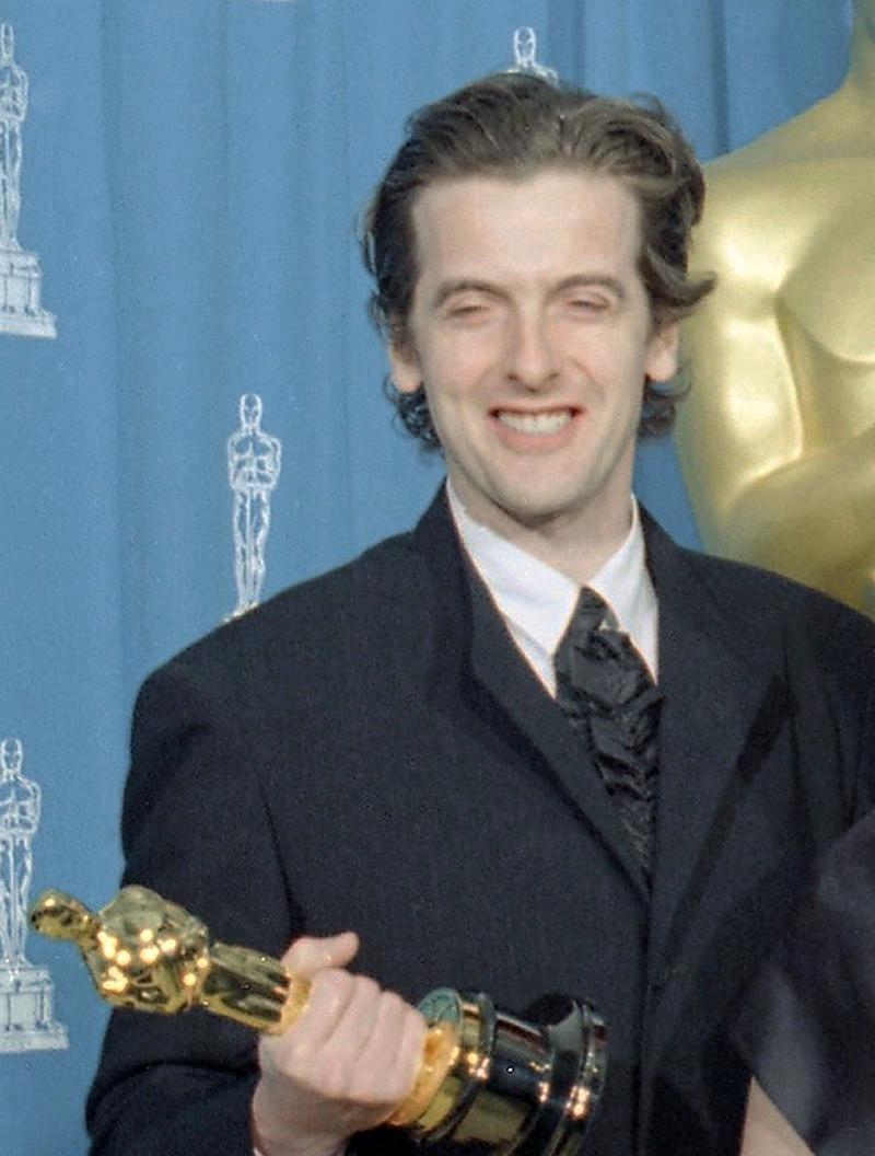 """FILE- Holding his Oscar for Live Action Short Film Peter Capaldi is awarded for """"Frank Kafka's It's Wonderful Life,"""" at the 67th annual Academy Awards in Los Angeles, USA, in this file photo dated Monday, March 27, 1995. British actor Peter Capaldi is named late Sunday Aug. 4, 2013, as the next lead star of the long-running science fiction series """"Doctor Who."""" (AP Photo/Lois Bernstein, FILE)"""