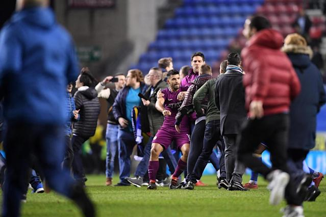 Wigan fined £12,500 for pitch invasion after FA Cup win vs Manchester City