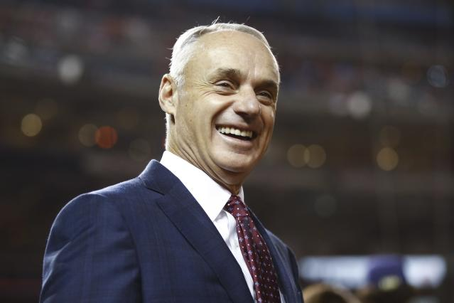 MLB commissioner Rob Manfred smiles at batting practice before Game 4 of the baseball World Series between the Houston Astros and the Washington Nationals Saturday, Oct. 26, 2019, in Washington. (AP Photo/Patrick Semansky)