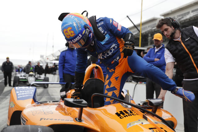 IndyCar driver Fernando Alonso, of Spain, climbs into his car during testing at the Indianapolis Motor Speedway in Indianapolis, Wednesday, April 24, 2019. (AP Photo/Michael Conroy)