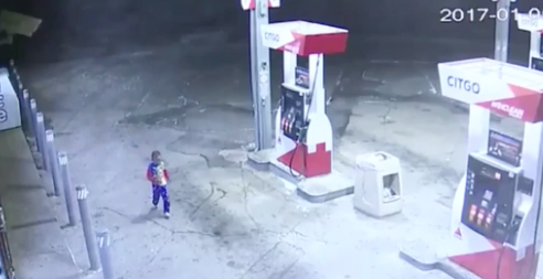 The boy was filmed running around the service station about 4.30am. Photo: WXYZ News.