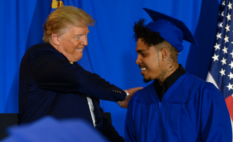 US President Donald Trump hands out diplomas after deliverig the commencement address at a Hope for Prisoners graduation ceremony in Las Vegas, Nevada, on February 20, 2020. (Photo: JIM WATSON/AFP via Getty Images)