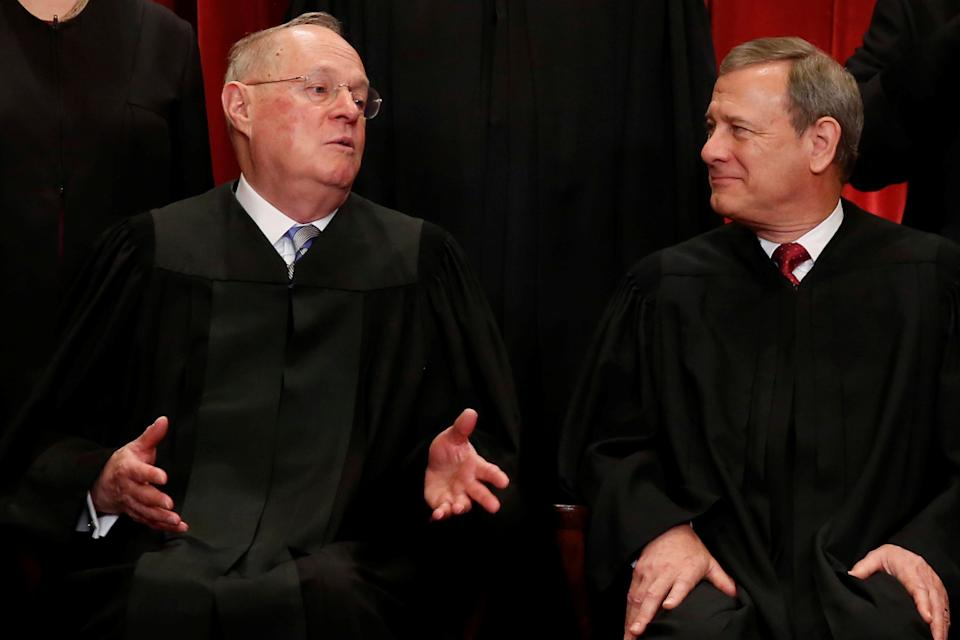 U.S. Supreme Court Justice Anthony Kennedy (L) chats with Chief Justice John Roberts (R) during a new U.S. Supreme Court family photo including Justice Neil Gorsuch (not pictured), their most recent addition, at the Supreme Court building in Washington, D.C., U.S., June 1, 2017.