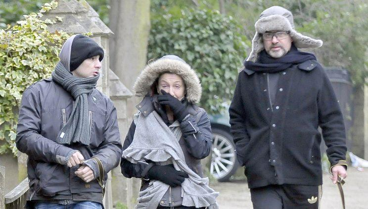 George Michael spotted out walking his dog with his friends in London (WENN)