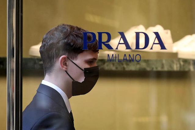 A Prada employee wears a mask in Moscow on 25 March. (Getty Images)